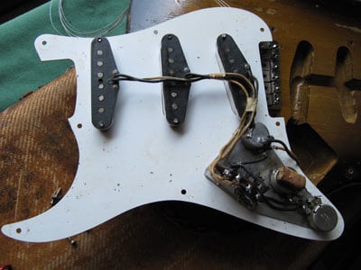 1956 pickguard with the shielding foil that covered the control area only