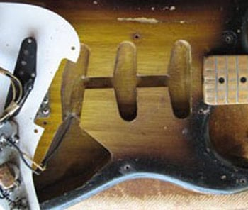 Rounded edges of the pickup cavities on a 1956 Stratocaster
