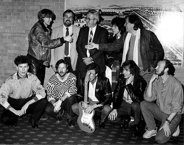 1986 party for Hank Marvin at Hilton, London. Back, from left: Hal Lindes, Dan Smith, Bill Schultz, Jeff Beck, David Gilmour; front, from left: Stuart Adamson, Eric Clapton, Hank Marvin, Stewe Howe, Richard Thompson.