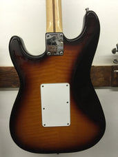 Strat Ultra back contour was black in order to hide the veneer back