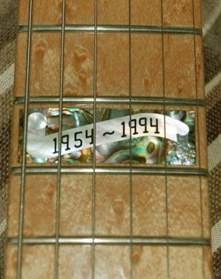 Inlay at 12th fret of the Diamond Dealer