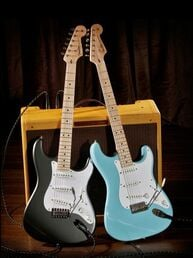 Dahne Blue and Gray Clapton Strats advert