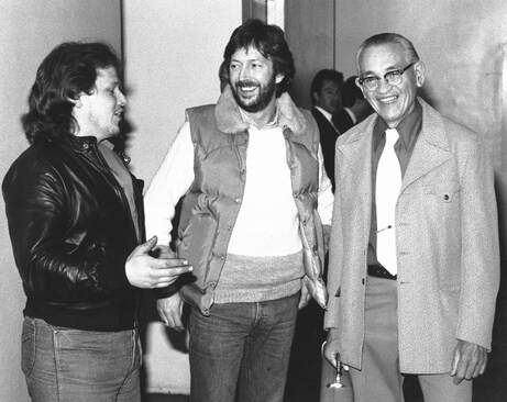 John Page and Freddie Tavares with Eric Clapton in 1983
